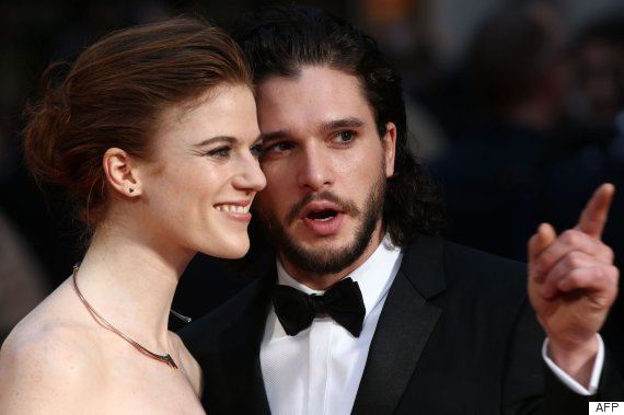 British actor Kit Harington (R) and British actress Rose Leslie (L) pose on the red carpet upon arrival to attend the 2016 Laurence Olivier Awards in London on April 3, 2016. / AFP PHOTO / JUSTIN TALLIS